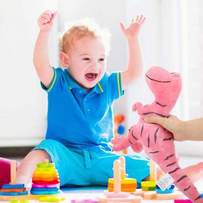 peluche dinosaure rose et bébé